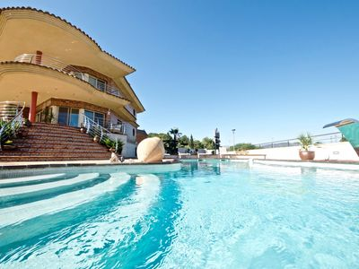 Photo for Sea front luxury villa sleeps 14 in the centre of the village.