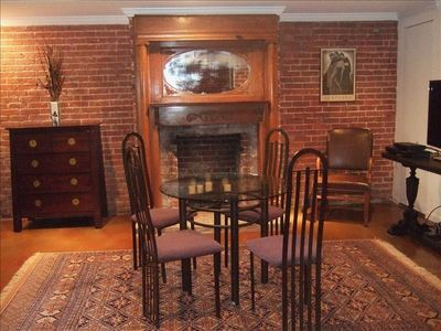 Great Room with dining table and fireplace
