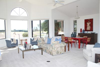 Living Room - Vaulted ceilings and tasteful artwork lead into the open living room