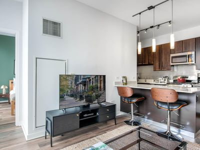 Photo for Tranquil River North 1BR w/ Gym, Pool, W/D, near the L, by Blueground