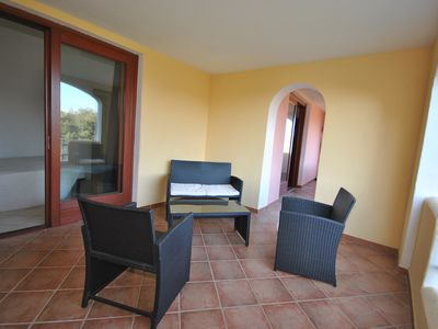Photo for PORTO SAN PAOLO 400 METERS FROM THE BEACH WITH SOLARIUM SEA VIEW