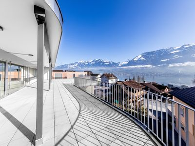 Photo for Modern villa with stunning lake and mountain views