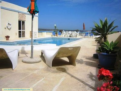 Photo for Bungalow with Fantastic Sea View - Large Outdoor Pool, Walking distance to Beach