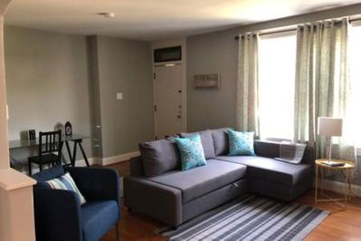 Living room with pullout couch and desk