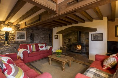 The lounge has a large woodburning stove set in an inglenook fireplace