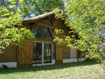 Photo for Luxury reconverted barn house with charm and character and large picture windows in the middle of a huge wooded park, near the ocean and golf courses
