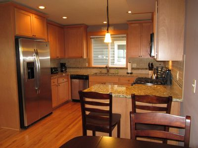 Spacious kitchen with granite counters and stainless appliances - fully equipped