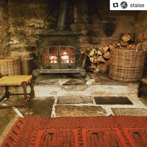 The fireplace, posted on instagram by one of our guests. @fennycastlevineyardcot