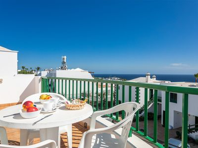 Photo for Fantastic ocean view apartment w/ free WiFi, terrace & shared pool!