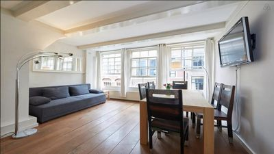 Photo for Bright apartment in Rembrandt Square in the center of monumental building