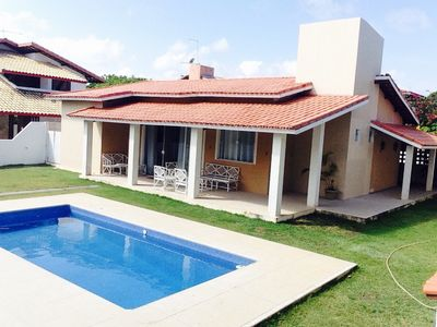 Photo for House 4 suites Guarajuba. 100m from the beach. Paradise Condo.