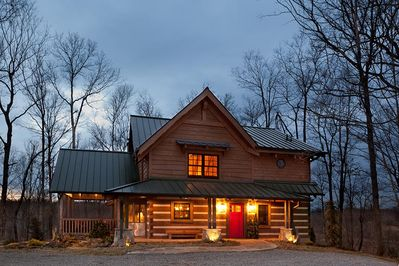 Caspian Cottage, nestled in the trees. Ample parking, screened-in porch.