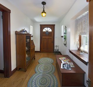 The front foyer features a large closet filled with games and extra blankets