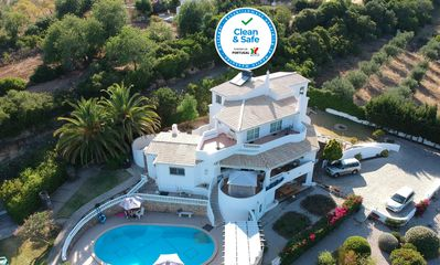 Photo for Luxury Villa with Grand Pool and Lush Garden in the Heart of the Algarve