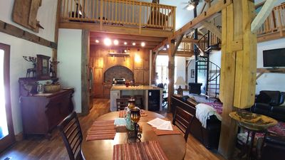 Dining room, kitchen, view of small game room loft and view right living room
