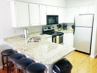 Fully stocked kitchen with granite countertops and stainless steal appliances