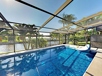 Photo for New Listing! Canal-Side Home w/ Boat Dock & Screened Lanai w/ Hot Tub & Pool