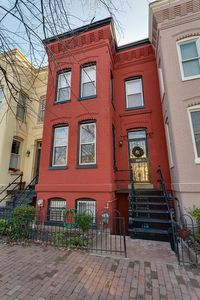 Classic Capitol Hill row-house, with original cast iron stairway