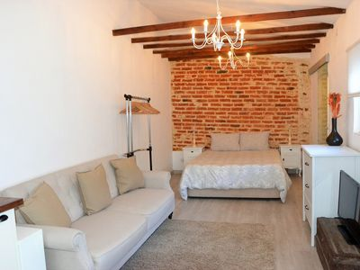 Photo for Charming Brick Wall Studio with patio in Belem