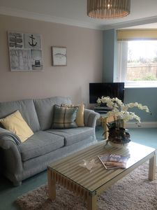 Photo for Beautiful refurbished south facing apartment with a stroll across to the beach.