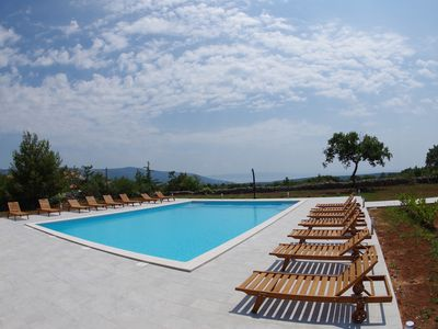 Photo for Holiday apartment, shared pool, big garden and bbq, 1800m from the beach, Rakalj