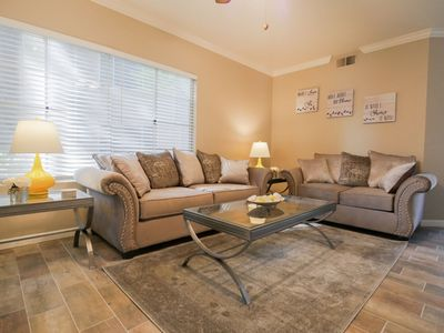 Spacious living room with very comfortable new couch and loveseat