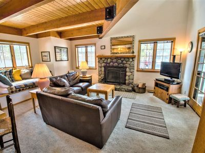 Photo for Beautiful forest surrounded home with private hot tub & bikes