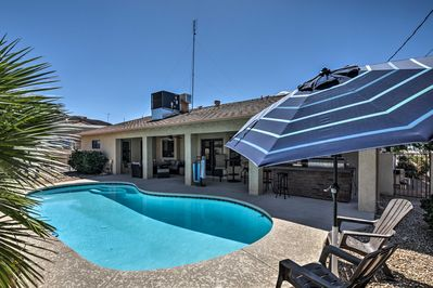 Stay cool in your private pool of this 3BR, 2-bath Lake Havasu vacation rental .