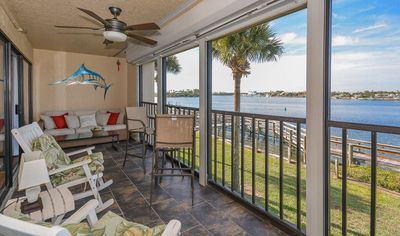 Spend your days on the large screened patio with 2 rocking chairs, sofa and a high-top table for 2.