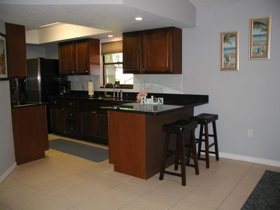 BEAUTIFUL OPEN KITCHEN W/EAT IN BAR. OPENS UP TO THE DIN/LIV RM, PATIO AREA