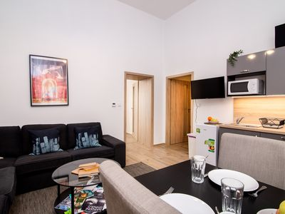 Photo for Modern apartment w/ WiFi - 2 blocks to the river, 1/4 mile to Kampa Island!