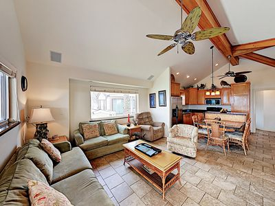 Living Area - Relax in style in the open living area, furnished with a queen sleeper sofa, love seat, and 2 armchairs.