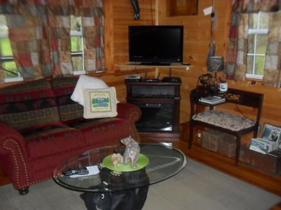 living area , electric fireplace, cable tv, internet with wifi, landline phone