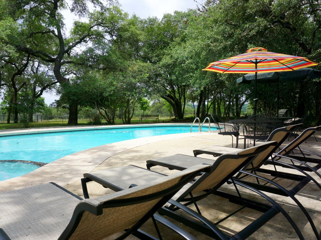 Enchanting 10 bedroom home located on 200 acres with pool! Sleeps 22!!!