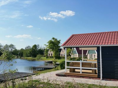 Photo for Beautiful lodges with veranda, located on pond of spacious holiday park