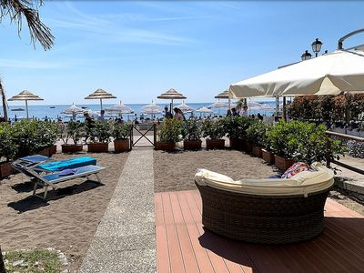 Photo for Villa Pamela A: A bright and cheerful apartment located right on the Spiaggia Grande beach , with Free WI-FI.