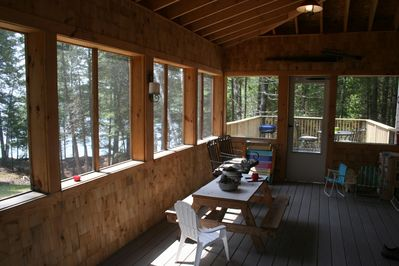 Screened porch and open deck all with lake and woods views. Now with Gas BBQ.
