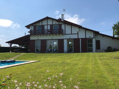 Photo for Bright and quiet villa, heated swimming pool near beaches