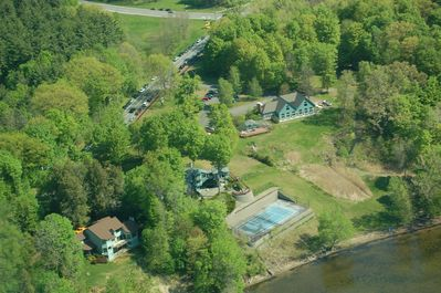 Aerial view: Lake house upper right with twin peaks; tennis court yours to use !