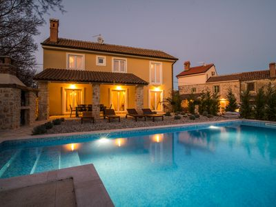 Photo for Luxury villa with pool and barbecue, surrounded by green areas, modern furnishings