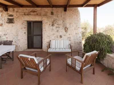 Photo for Trullo Ilario apartment in Torre Suda with shared terrace & shared garden.