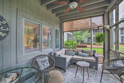 Relax on the screened-in porch and gaze out at the community pond.