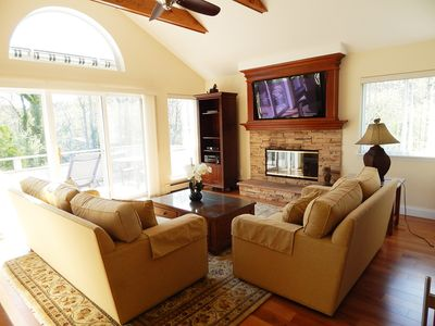 Living Room cathedral ceilings with large flat screen TV over gas fireplace