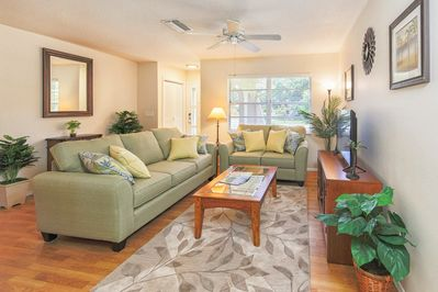 Cozy stylishly decorated living room has large flat screen HD TV, DVR and BluRay