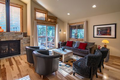 Living Room - Welcome to Truckee! Your rental is professionally managed by TurnKey Vacation Rentals.The modern yet comfortable living room with cathedral ceiling and fireplace
