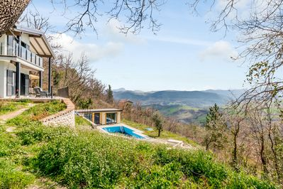 The site with Casa In Legno on the upper terrace with the Poolhouse below.