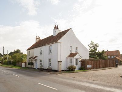 Photo for Pretty white-washed three bedroom cottage with distant marsh views