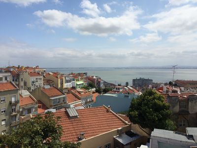 Photo for Hilltop sunny water view apartment in historical Graça steps from Alfama