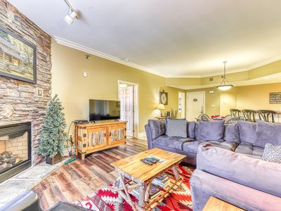 Photo for Elegant condo right downtown w/ balcony & shared pool/hot tub/fitness room!