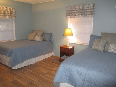 Master w/ 2 double beds, all new bedding.